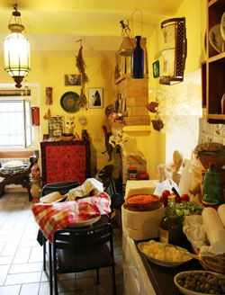 The warm, cozy kitchen of the Tarot Museum is so inviting